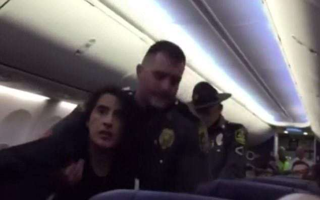 Shocking moment cops drag a woman off a Southwest Airlines plane as she complains about her 'life-threatening allergies' to a passenger's support dog